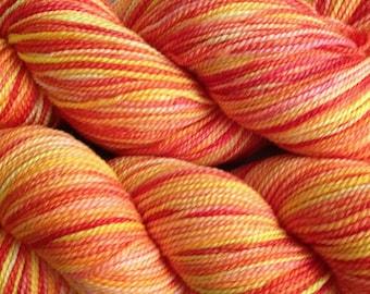 Fingering Weight Hand Painted Merino Wool Sock Yarn in Sunset Red Orange Pink Yellow