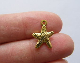 12 Starfish charms antique gold tone GC37