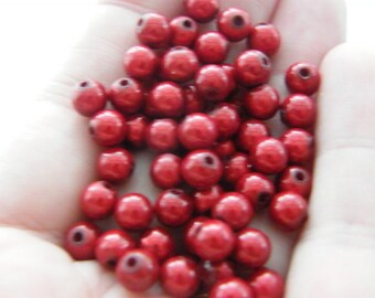200 Christmas red miracle beads B110