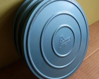 Vintage Film Reels and Cases . Three Cases/Two Reels . Steely Blue Metal