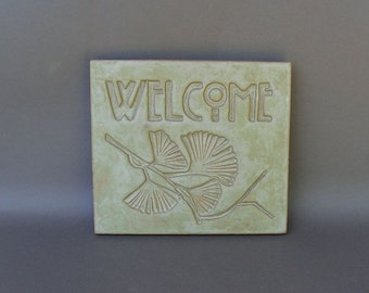 "Light Green Stoneware ""Welcome"" Tile with Embossed Ginkgo Twig Design"