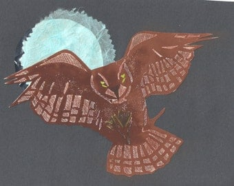 Owl flying in front of a full moon