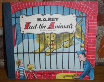 H. A. Rey Feed The Animals Book w/Flaps + FAO Swartz Sticker Softcover Zoo 70s