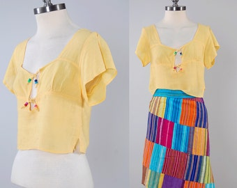 Vintage 70s yellow Indian cotton gauze blouse / Hippie crop top / Beaded ties at bust