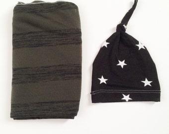 Baby boy swaddle blanket and hat set. Olive green stripe blanket with black star knot hat.