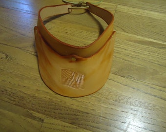Adult handcrafted light tan leather visor with tie back American Flag and words USA on each side
