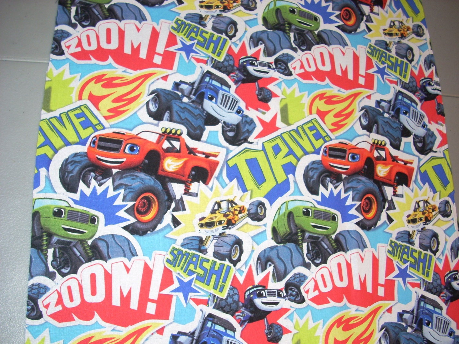 Blaze and the monster trucks cotton fabric 15 by for Monster truck fabric