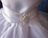 communion dress with rhinestone and ribbon trim will fit your 18 inch doll such as American Girl