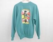 vintage TITANS 90s warrior teal soft sweatshirt