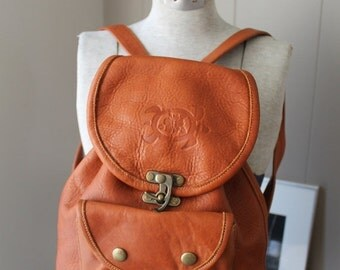 ON SALE Vintage leather backpack daypack brass swing clasp turtle tortoise insignia tooled