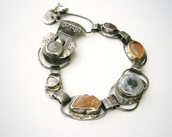 Sandia Mountain Granite/Solar Quartz/Rose Cut Red Diamond/Ruby/Oregon Sunstone/Pomegranate FlowerPetal/Grey Sapphire Contraption Bracelet