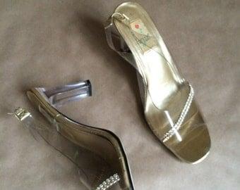 1990's Cinderella's glass slipper / clear pumps / heels / plastic shoes