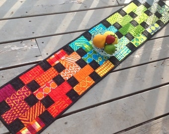Bright Variety quilted table runner in vivid colors with black
