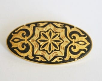 Vintage damascene brooch. Black and gold brooch