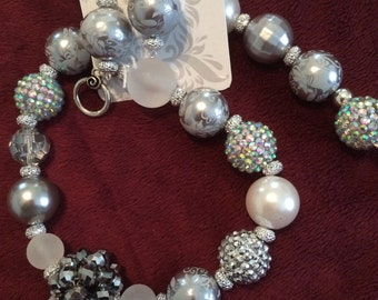 Silver colored bling necklace and earrings