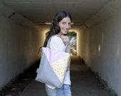 pink and grey canvas tote bag in geometric pattern and with zippered closure