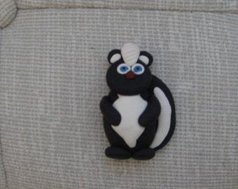 polymer clay skunk refrigerator magnet