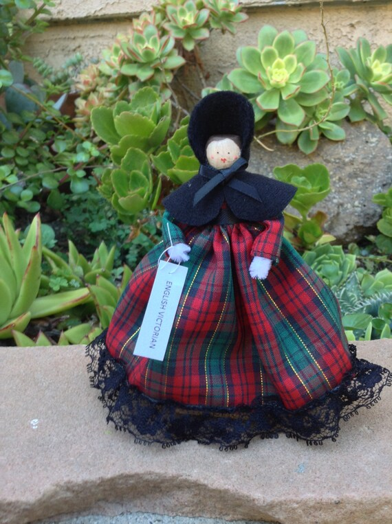 English Victorian clothespin doll, black, red, green dress