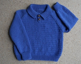 Jumper/sweater/polo shirt hand knitted in blue acrylic yarn.  Vintage pattern. Chest 24 in, age approx 2 years.