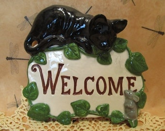 Black Cat welcome sign