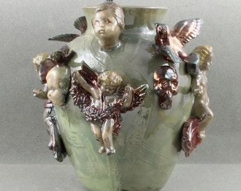 Handmade Raku Urn Covered with Angels Devils Skulls Birds and Cherubs Titled Dreams of a Child  Oscarcrow