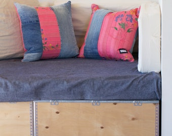 Pillows made from a handwoven and hand painted textile and recyled denim