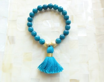 Faceted Teal Jade and Stardust Round Bead Stretch Bracelet with Teal Cotton Tassel (B1208)