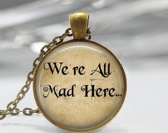 ON SALE Alice In Wonderland Necklace We're All Mad Here Jewelry Book Quote Fairy Tale Art Pendant in Bronze or Silver with Link Chain Includ