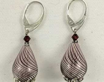 Light and lovely handblown grey striped teardrop glass earrings.