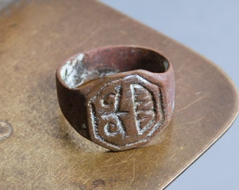 Antique  brass woman signed ring. Original dark patina.