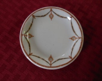 Vintage/Antique Butter Pat Dish White With Design Red/Yellow Ribbon Looking Tiny 1900s