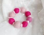 FINAL SALE Hand felted bracelet in shades of pink (pale pink, rose). Pink shells. Romantic and delicate. Felt balls, fiber art