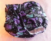 SassyCloth one size pocket cloth diaper with geeky girly PUL print. Ready to ship.