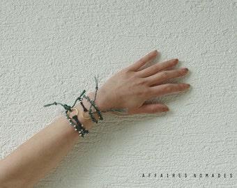 Braided beaded bracelet linen thread hand dyed bohemian tassel bracelet. nuance of blue