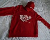 Winged Heart sweatshirt/hoodie/t-shirt. Detroit: Show off your love for HockeyTown and the Red Wings with this classic sweater.