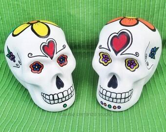 Ceramic Skulls, set of 2. Hand painted by Susie Carranza. Sugar skull inspired.