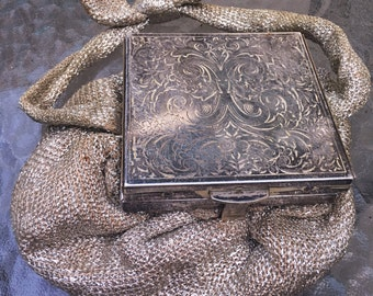 20's/30's silver cosmetic compact wristlet