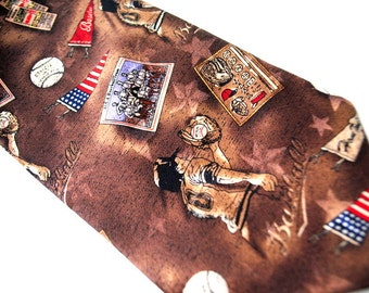 Vintage 80s light brown silk  necktie with  americana series  baseball - early teams. Made by  Tango.