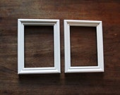 2 white frames - pair of matching white 5x7 picture frames