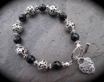 "Silver Filigree Toggle bracelet with black onyx beads, and heart charm 7 1/2"" Black and Silver bracelet"