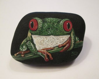 Red-Eyed Tree Frog hand painted on a rock by Ann Kelly
