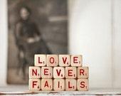 vintage letter cube words LOVE NEVER FAILS