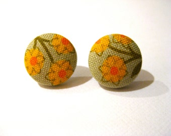 Fabric covered button earrings with a floral pattern in green, yellow and orange