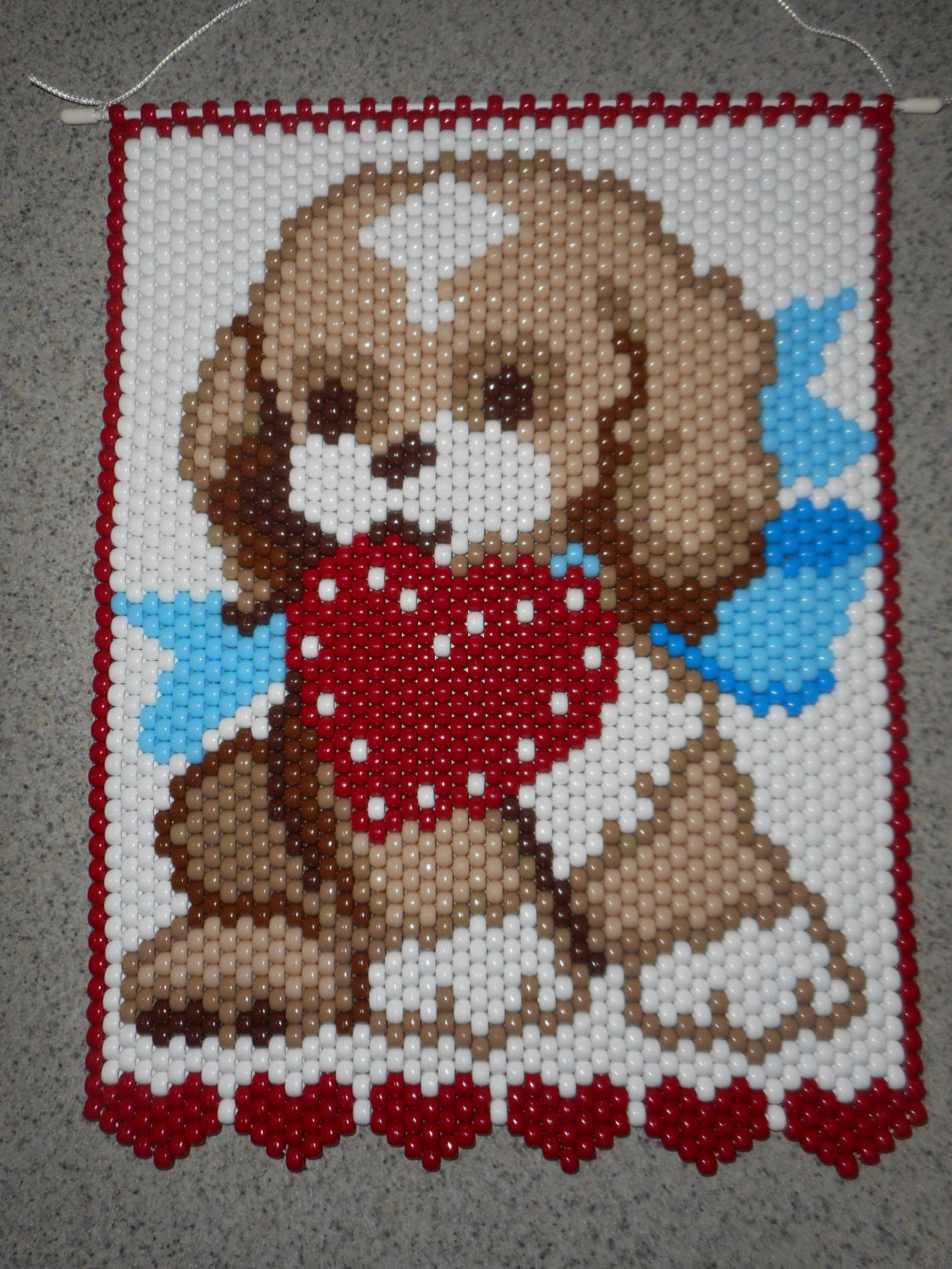 handmade puppy beaded banner with cord