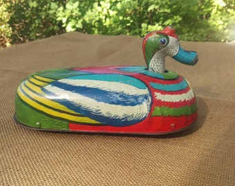 Vintage tin lithograph wind up duck toy