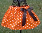 orange polka dot skirt