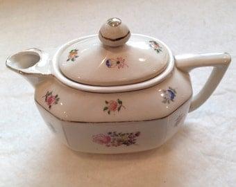 Interesting Little Floral Tea Pot