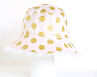 Girl's sun hat in pink and gold polka dots for baby or child