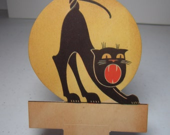 1920's unused die cut halloween place card arched back hissing black cat against full moon international art publishing company
