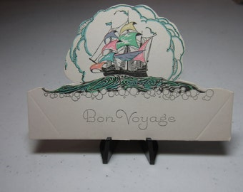 Art Deco 1920's-30's unused die cut Rust Craft Bon Voyage place card ship sailing on ocean with multi colored masts cloud burst